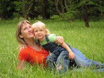 Happy woman with child Stock Photos