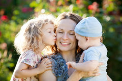 Happy woman with child and baby Stock Photography