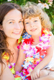 Happy woman with child on the beach Royalty Free Stock Photo
