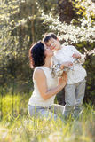 Happy woman and child in the blooming garden stock images