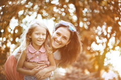 Happy woman and child in the blooming spring garden.Mothers day holiday concept Stock Photography