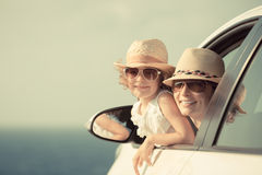 Happy woman and child in car Stock Photos