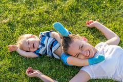 Happy woman and child having fun outdoor on meadow Royalty Free Stock Photos