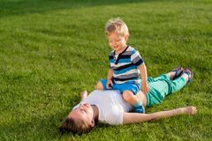 Happy woman and child having fun outdoor on meadow Stock Photography