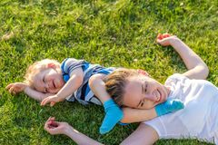 Happy woman and child having fun outdoor on meadow Royalty Free Stock Image