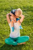 Happy woman and child having fun outdoor on meadow Stock Images