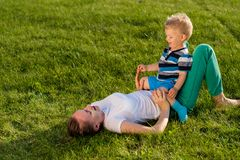 Happy woman and child having fun outdoor on meadow Royalty Free Stock Photography