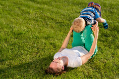 Happy woman and child having fun outdoor on meadow Royalty Free Stock Photo