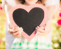 Happy woman and child holding heart Royalty Free Stock Photo