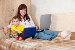 Happy woman and child with laptops Royalty Free Stock Images