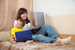 Happy woman and child  with laptops Royalty Free Stock Photo