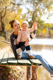 Happy woman with child outdoors Royalty Free Stock Photos