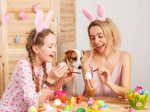 Happy woman with child paint easter eggs Stock Photo