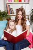 Happy woman and child reading a book Royalty Free Stock Images