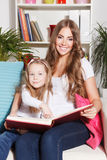 Happy woman and child reading a book Royalty Free Stock Photography