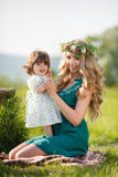 Happy woman with a child resting on the nature Royalty Free Stock Images