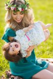 Happy woman with a child resting on the nature Stock Photos