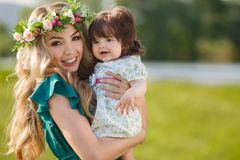 Happy woman with a child resting on the nature Stock Images