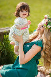 Happy woman with a child resting on the nature Royalty Free Stock Image