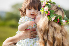 Happy woman with a child resting on the nature Royalty Free Stock Photography