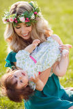 Happy woman with a child resting on the nature Stock Photography