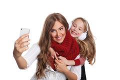 Happy woman and child taking a selfie Royalty Free Stock Image
