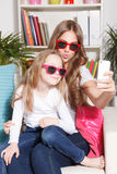 Happy woman and child taking a selfie Royalty Free Stock Photography