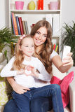 Happy woman and child taking a selfie Stock Photo