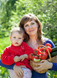 Happy woman and child with   vegetables Stock Photography