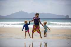 Happy woman and children on beach Stock Image
