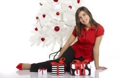 Happy woman with Chirstmas gifts Stock Image
