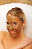 Happy woman with chocolate mask Stock Photos