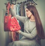 Happy woman choosing bag Royalty Free Stock Image