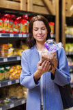 Happy woman choosing and buying food in market Stock Photo