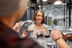 Happy woman choosing cake at vegan cafe Stock Photography