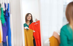 Happy woman choosing clothes at home wardrobe. Clothing, fashion, style and people concept - happy woman choosing clothes at home wardrobe Stock Image