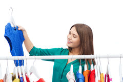 Happy woman choosing clothes at home wardrobe. Clothing, shopping, fashion, style and people concept - happy woman choosing clothes at home wardrobe Royalty Free Stock Image