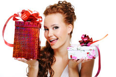 Happy woman choosing between two presents. Happy laughing woman choosing between two presents Royalty Free Stock Photography