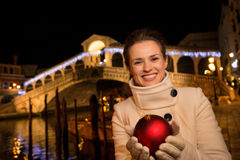 Happy woman with Christmas Ball near Rialto Bridge in Venice Royalty Free Stock Image