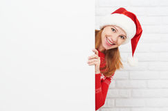 Happy woman at Christmas with blank empty white poster Stock Photo