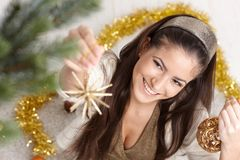 Happy woman at christmas decoration Stock Photo