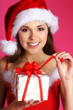 A happy woman in a Christmas dress Royalty Free Stock Photo