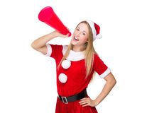 Happy woman with christmas dress shout with megaphone Stock Photo