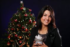 Happy woman with Christmas gift Stock Photos