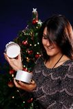Happy woman with Christmas gift Royalty Free Stock Photo
