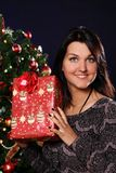 Happy woman with Christmas gift Royalty Free Stock Photography