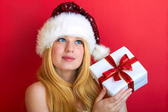 Happy woman with christmas gift Royalty Free Stock Image