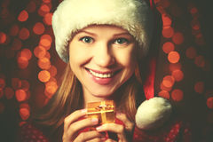 Happy woman with christmas gift Stock Image