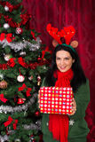 Happy woman with Christmas gift Stock Photo