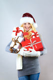 Happy woman with christmas gifts Stock Photography